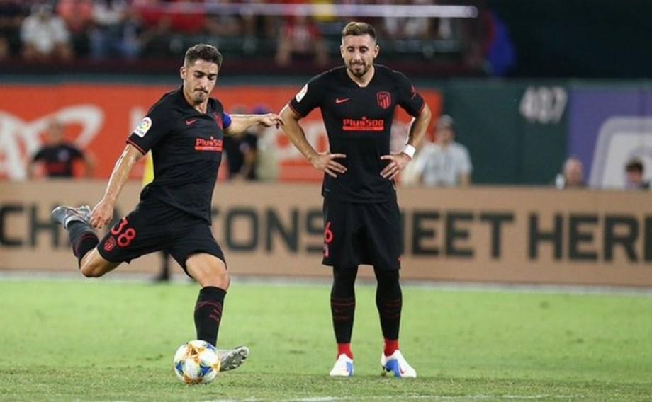 Atletico held at Valencia as Liverpool loom