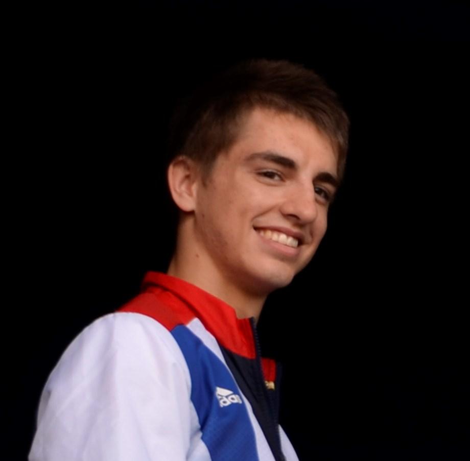 Gymnastics-Britain's Whitlock captures third pommel horse world title