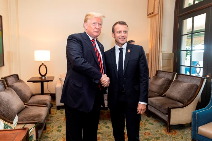 Macron, Trump in show of coziness after row over Europe's defence