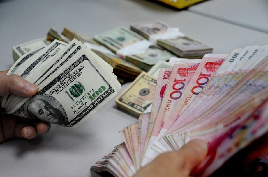 Chinese stocks open in green; yuan drops against US dollar