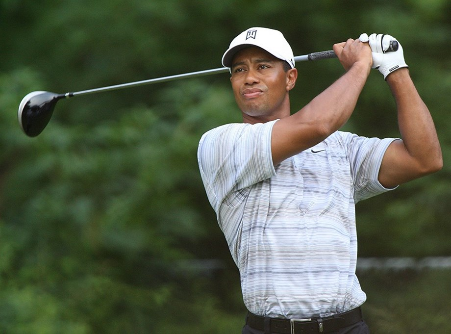 Golf-Woods selects himself as one of four captain's picks for U.S. team