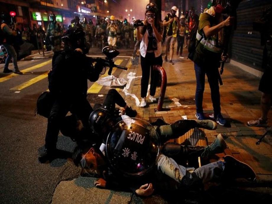 China says Hong Kong protests 'near terrorism' as airport reopens