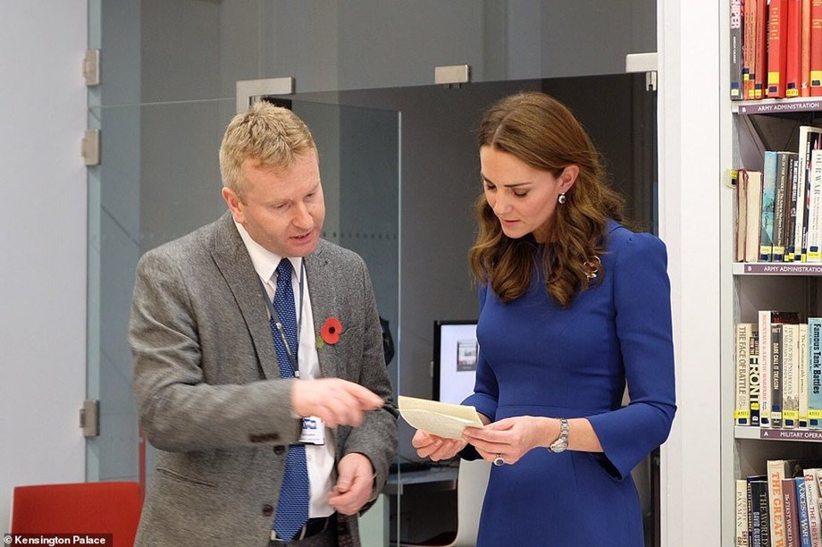 Britain's Duchess of Cambridge Kate reads letters of relatives died during WWI