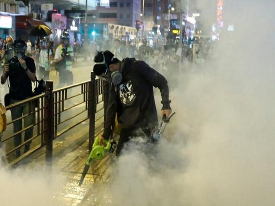 HIGHLIGHTS-Hong Kong paralysed for 5th day, students guard campuses