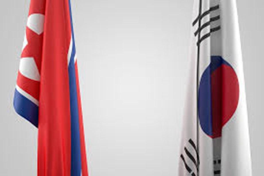 UPDATE 4-In bid to repair ties, Japan and S.Korea agree to summit next month