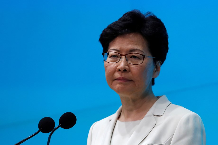 Hong Kong leader focuses on housing as protesters head for the hills