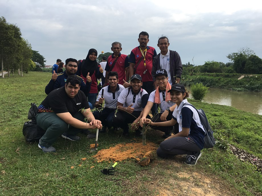 University students and locals plant trees at Kinta River in Malaysia